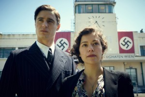 (L-R) MAX IRONS and TATIANA MASLANY star in WOMAN IN GOLD